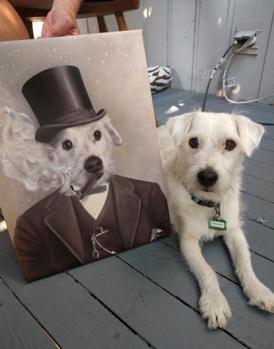 Dog sitting next to portrait of him with top hat and cigar