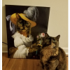 Cat next to its portrait as Marie Antoinette