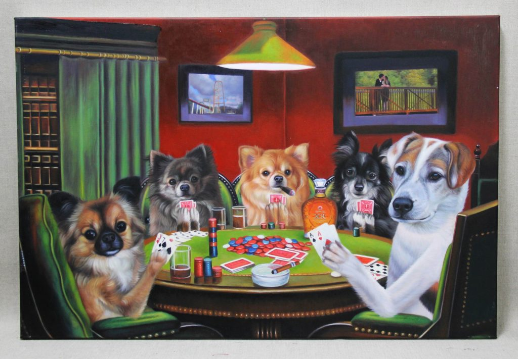 5 dogs at a table with games and drinks